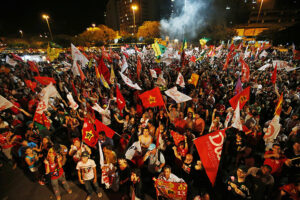 Supporters of Brazil's President Rousseff react to first results of runoff presidential elections in Porto Alegre